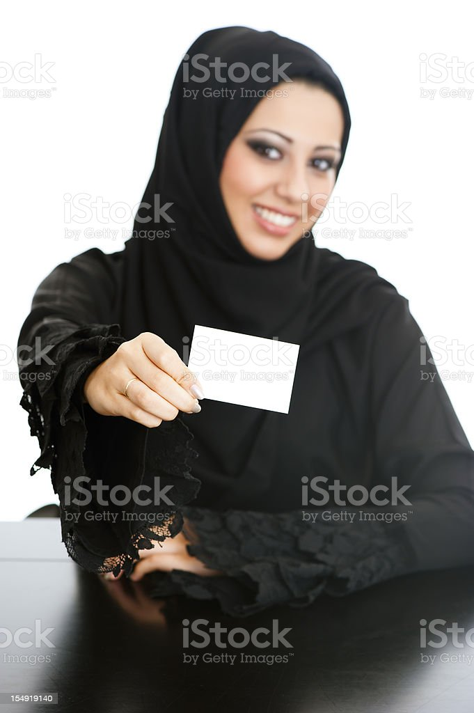 Happy Arabic girl holding card royalty-free stock photo
