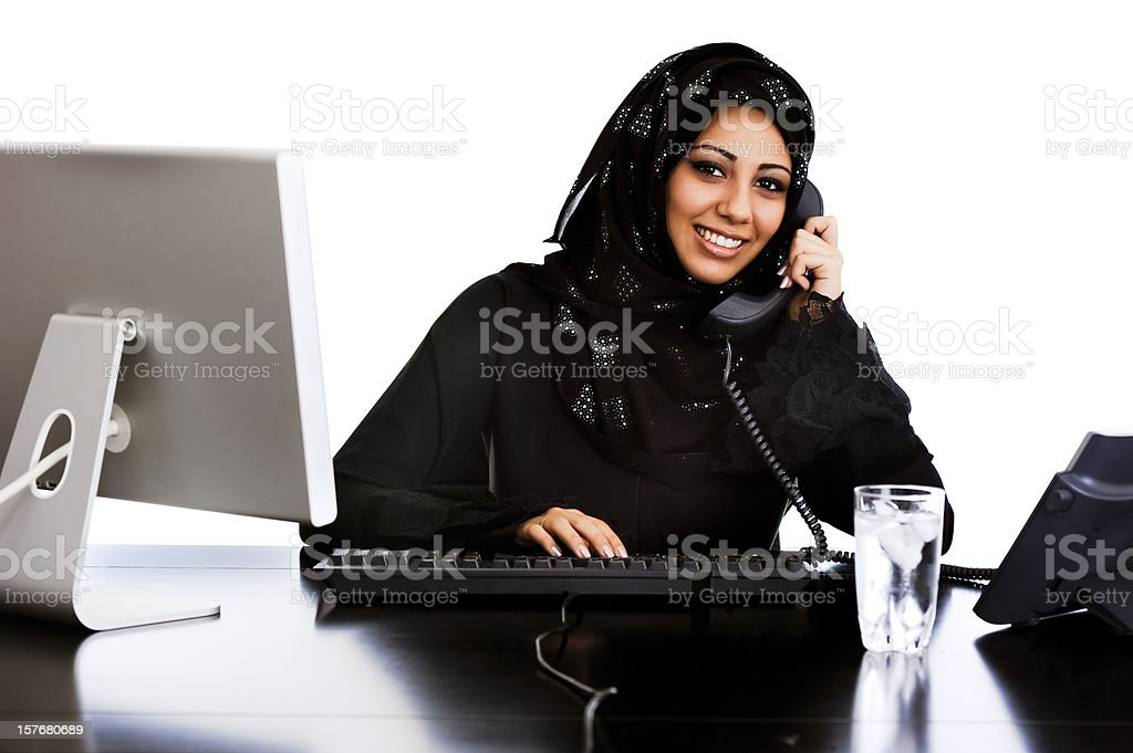 Happy Arabic girl working at her desk royalty-free stock photo