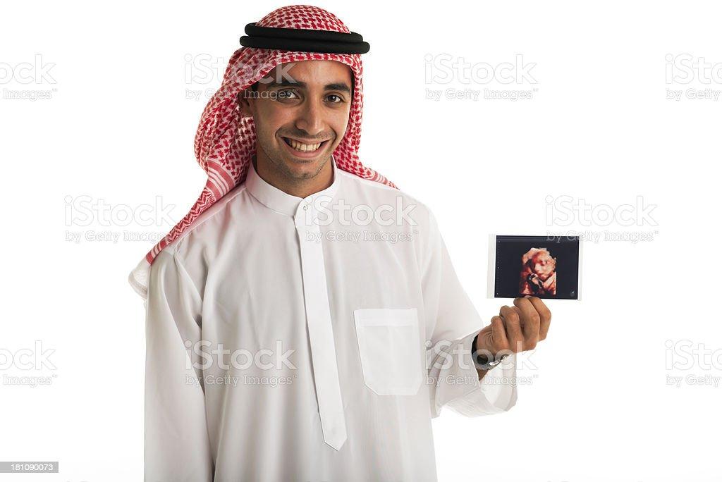 Happy Arabic man holding baby pic royalty-free stock photo