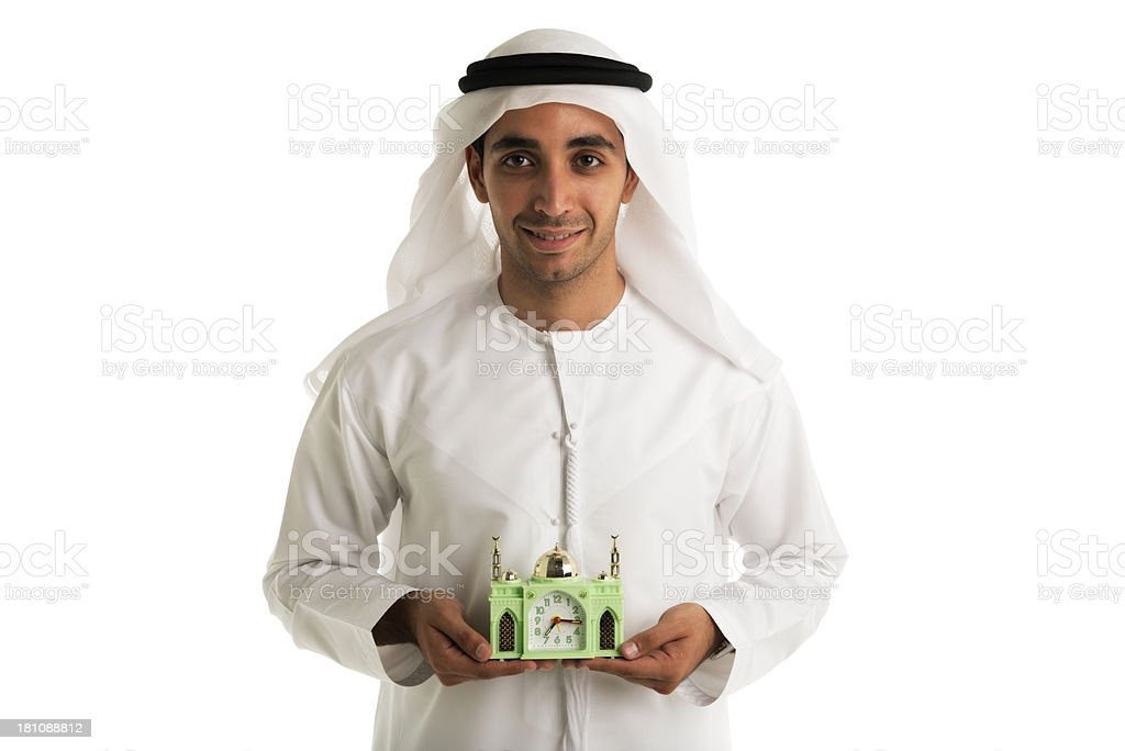 Happy Arabic man holding small mosque royalty-free stock photo