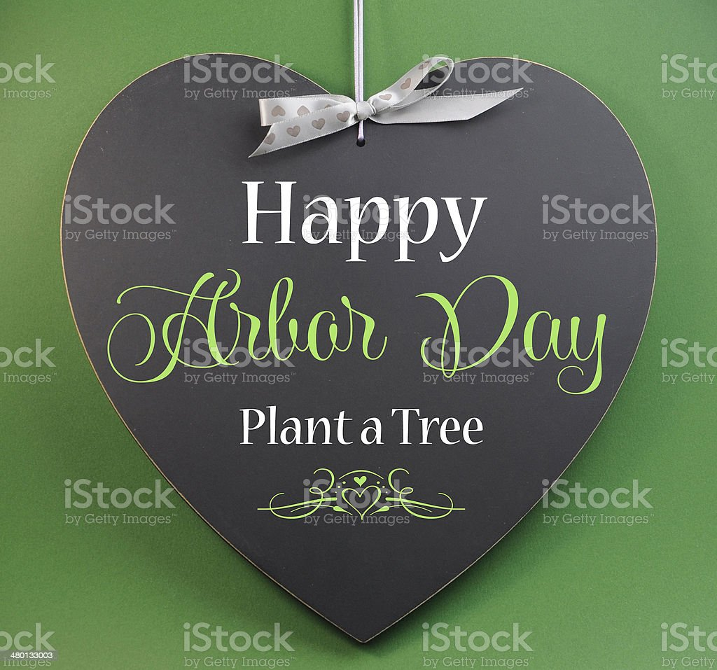 Happy Arbor Day, Plant a Tree, greeting message sign on heart shaped...