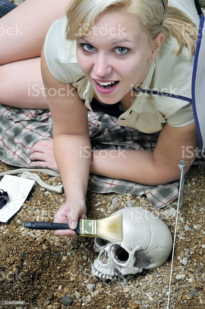 Happy Archaeologist Cleaning a Skull stock photo