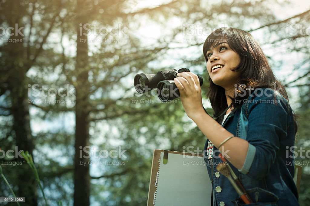 Happy Artist with binocular, drawing board and art tools. stock photo