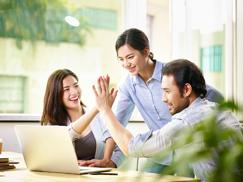 istock happy asian business team working together in office 851452718