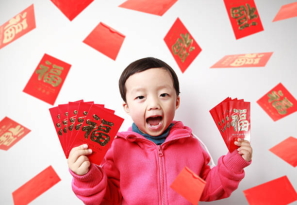 happy asian child showing red envelope stock photo