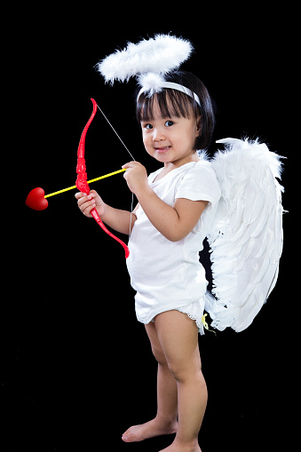istock Happy Asian Chinese Little Angel WIth Bow And Arrow 617608540