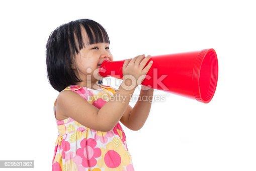 istock Happy Asian Chinese little girl holding retro loudspeaker 629531362