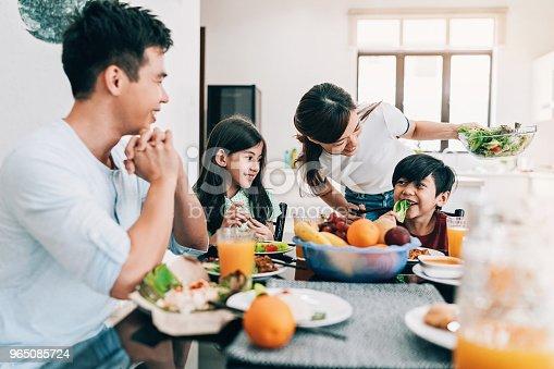Asian ethnicity family having breakfast at home