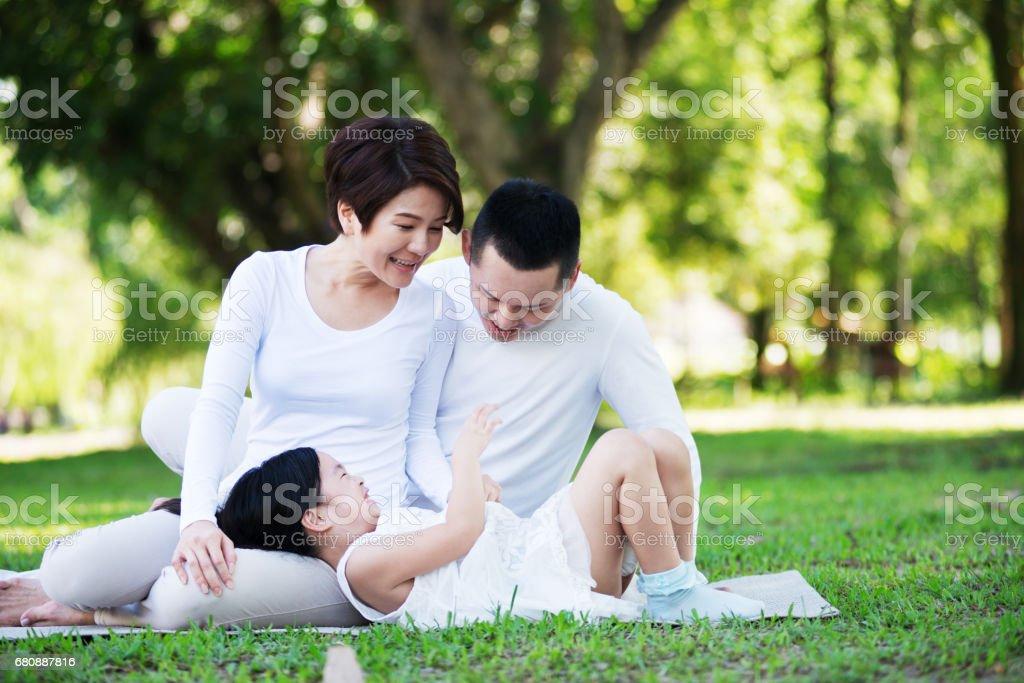 Happy Asian Family at the Park royalty-free stock photo