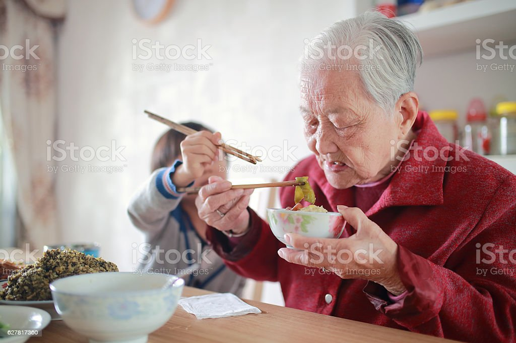 Happy Asian family enjoying lunc stock photo