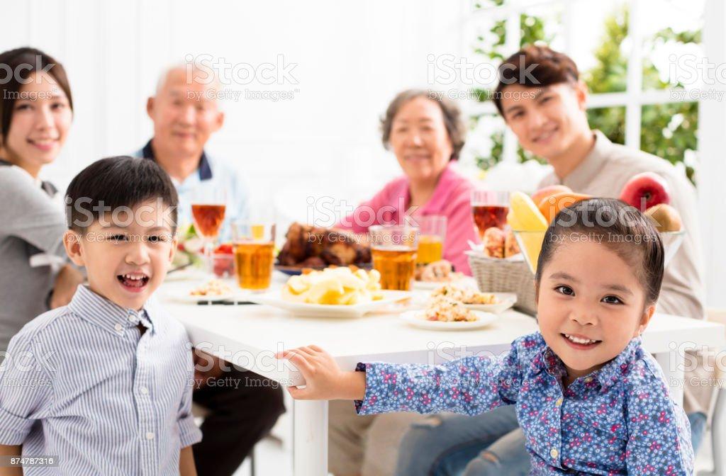 happy asian family having dinnerat home stock photo