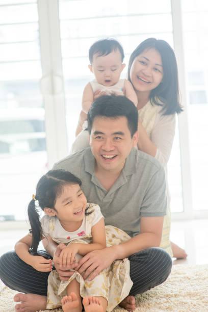 Happy Asian Family piggy back stock photo