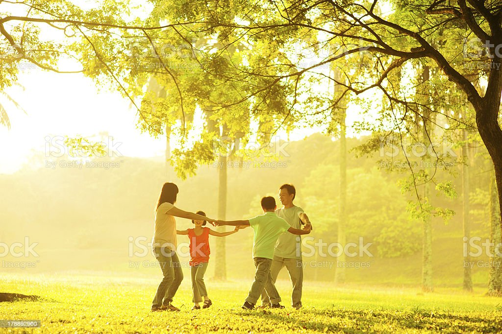 Happy Asian family playing stock photo