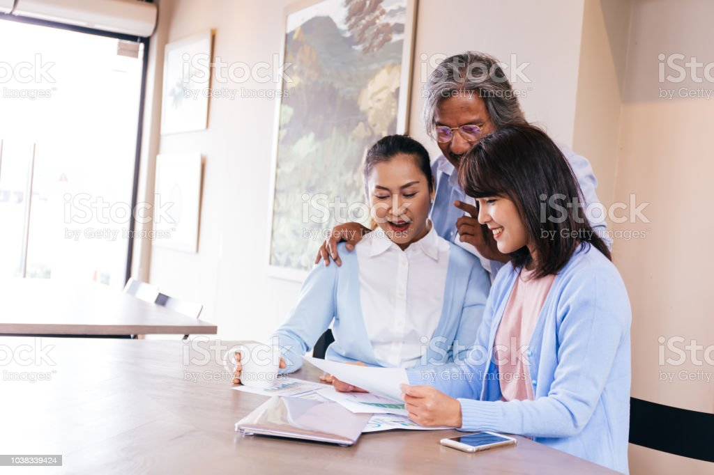Happy Asian family reading and receiving a good news letter together...