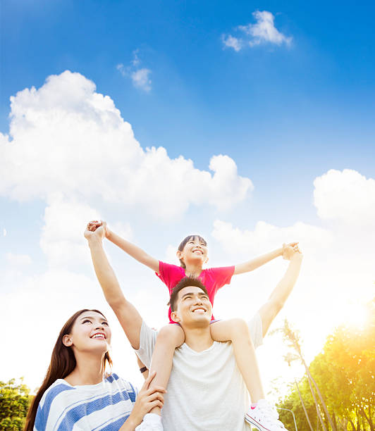 happy asian family with cloud background stock photo