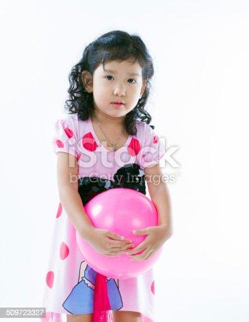544818734 istock photo Happy asian girl playing ball 509723327