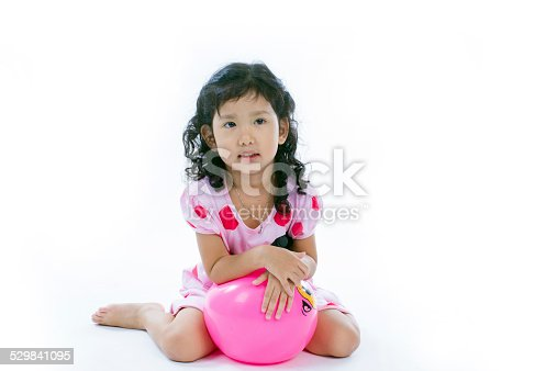 544818734 istock photo Happy asian girl playing ball 529841095