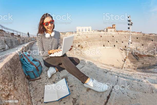 Happy asian girl student doing her homework with notebook pc or picture id1144965189?b=1&k=6&m=1144965189&s=612x612&h=ywdhniilhcdqfhnm4mubsoo3lcljkgdez6ghkh 32xu=