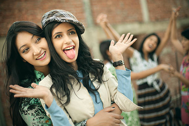 Happy Asian girls playing together and having fun in outdoor. stock photo