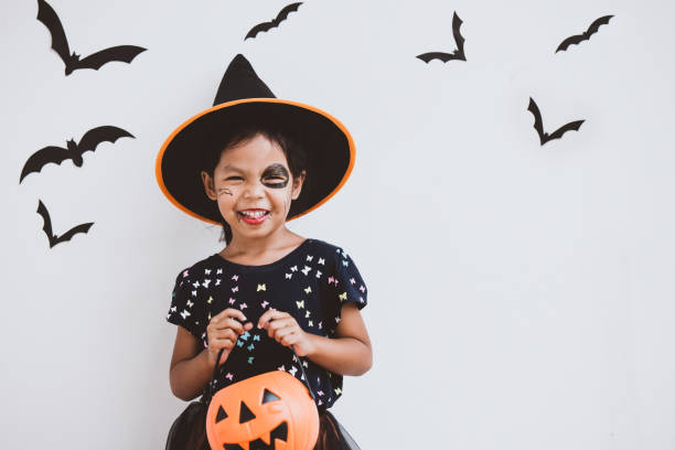Happy asian little child girl in costumes and makeup having fun on Halloween celebration Happy asian little child girl in costumes and makeup having fun on Halloween celebration costume stock pictures, royalty-free photos & images