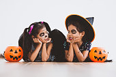 istock Happy asian little child girl in costumes and makeup having fun on Halloween celebration 1027435250