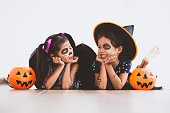 istock Happy asian little child girl in costumes and makeup having fun on Halloween celebration 1027435266