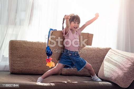 Portrait of happy Asian little child girl playing in an astronaut costume