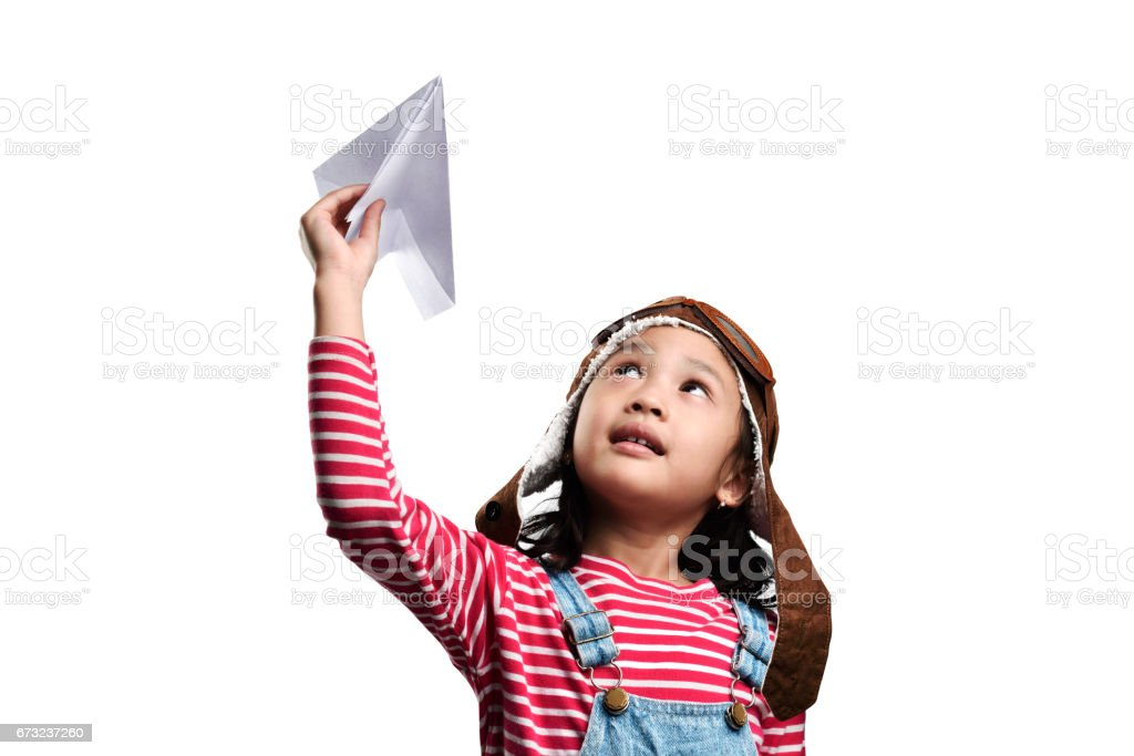 Happy asian little girl playing with toy paper airplane stock photo