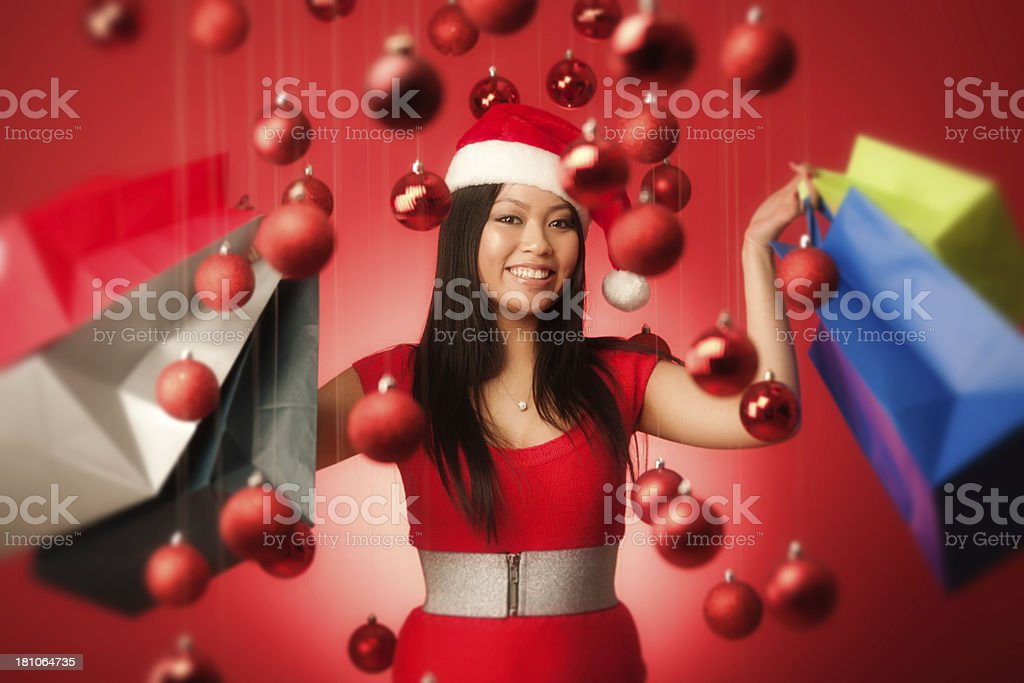 Happy Asian Santa Girl Shopping in Red Christmas Background Hz royalty-free stock photo