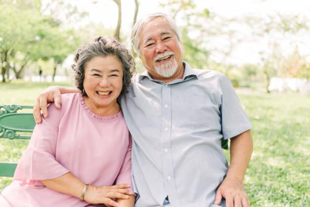 Happy Asian senior couple having a good time stock photo