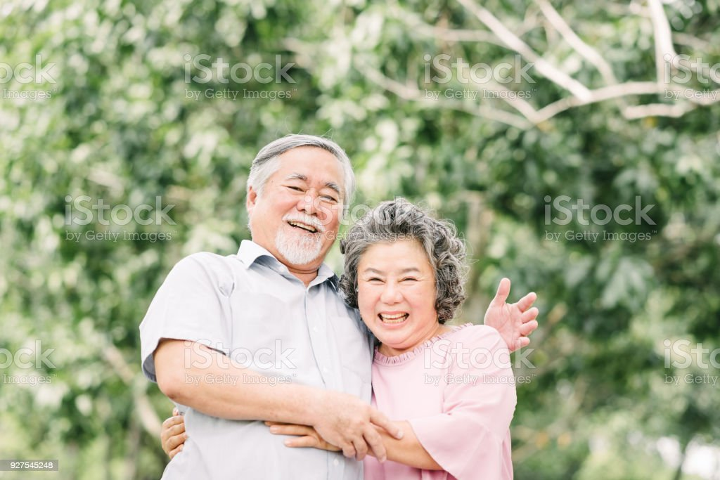 Happy Asian senior couple having a good time stock photo