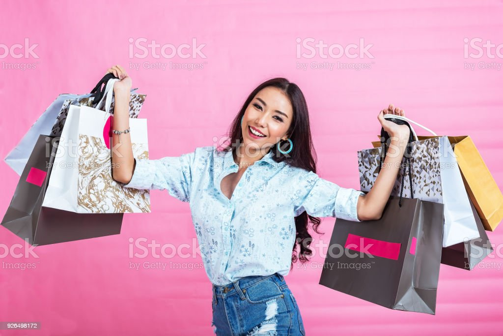 happy asian shopping girl with a lot of shopping bag