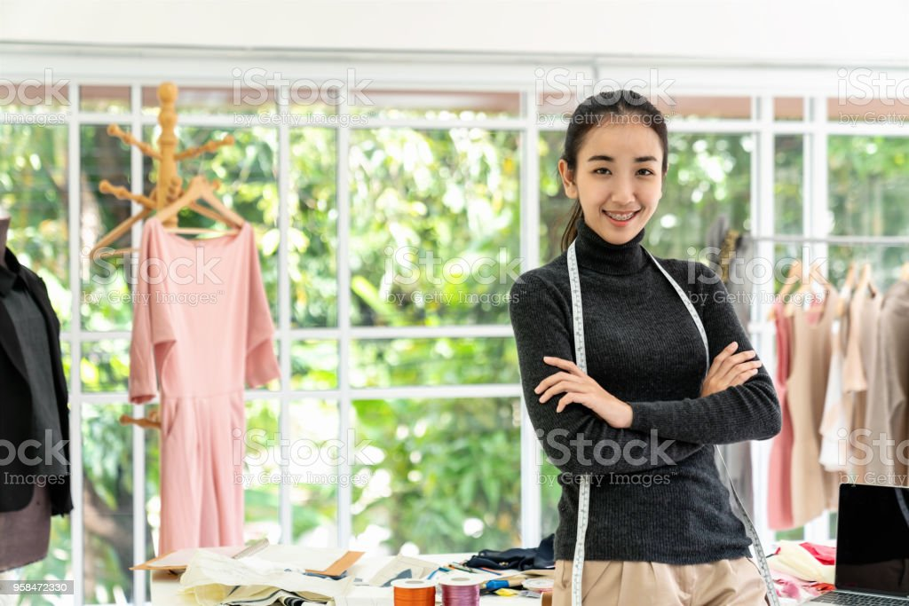 Happy Asian Smart Looking Fashion Designers Portrait In Modern Office Studio With Materialsthreadtextilelaptop On Desk With Copy Spaceyoung Creative Tailor Dress Makerstylishseamstress Concept Stock Photo Download Image Now Istock