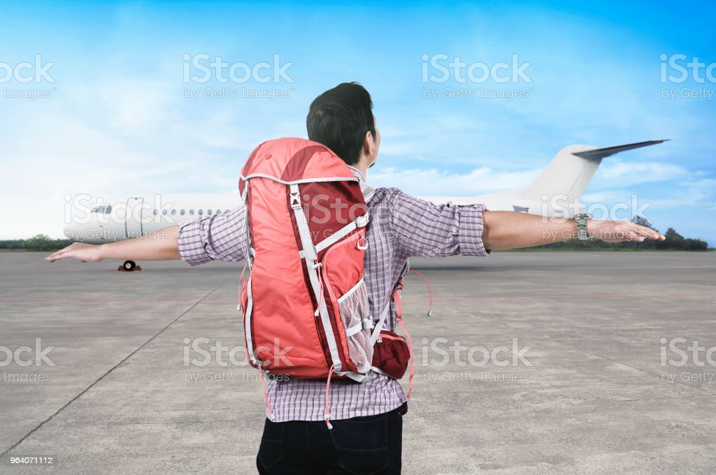 Happy asian traveler with backpack enjoying the trip - Royalty-free Adult Stock Photo