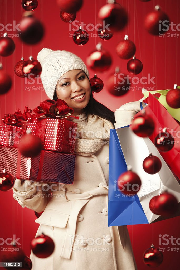 Happy Asian Woman Christmas Shopper with Shopping Bags and Gifts royalty-free stock photo
