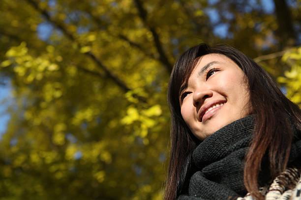Happy Asian Woman Portrait in Autumn - XXXLarge stock photo
