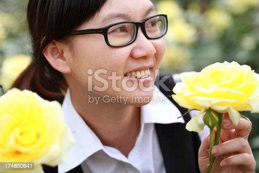 519052198 istock photo Happy Asian woman smiling in the garden 174850641