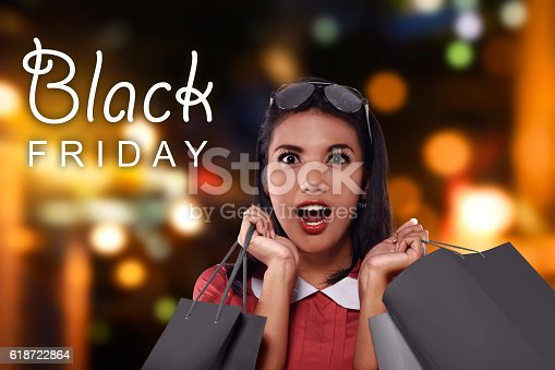 istock Happy asian woman with shopping bags 618722864