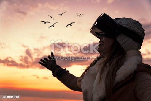 istock Happy Asian Woman with VR Embracing Nature 884885818