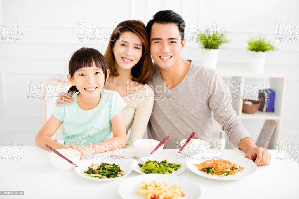 happy asian young Family enjoy their dinner stock photo