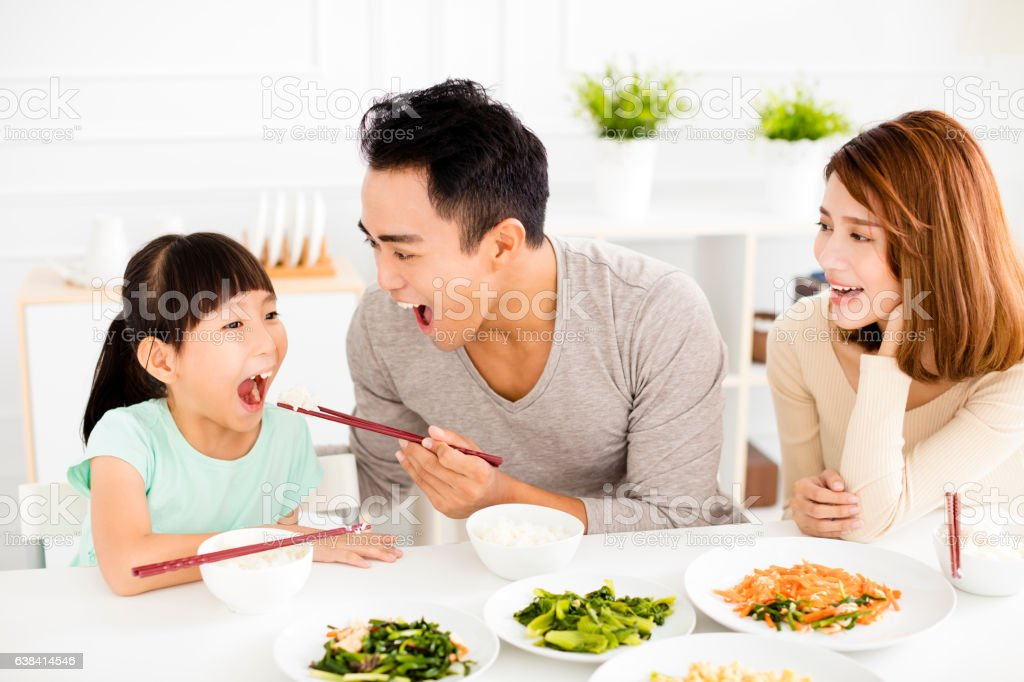 happy asian young Family enjoy their lunch stock photo