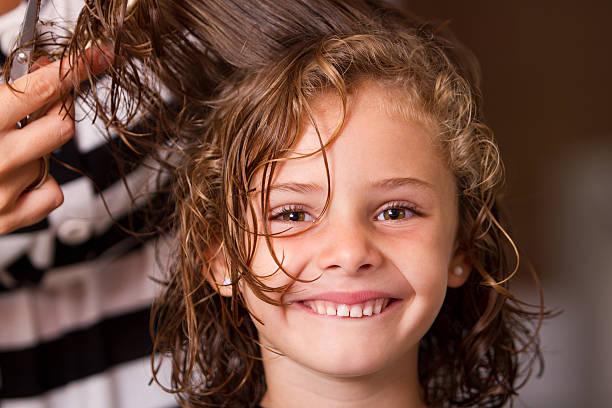 Happy at hair salon stock photo