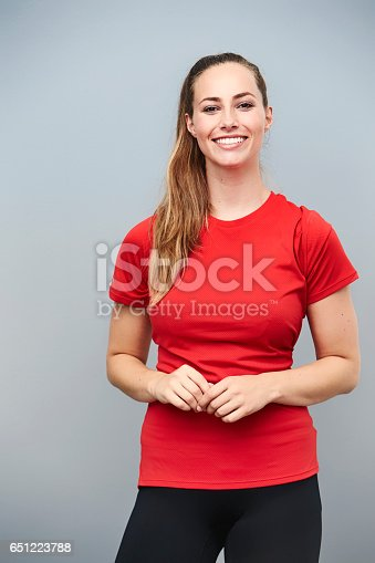 Happy athlete in red t-shirt, smiling