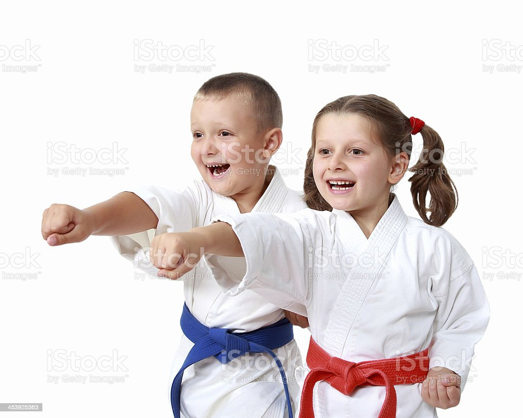 Happy athletes in a kimono beat punch arm stock photo