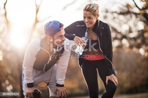istock Happy athletes taking a break from exercising in nature. 504933424