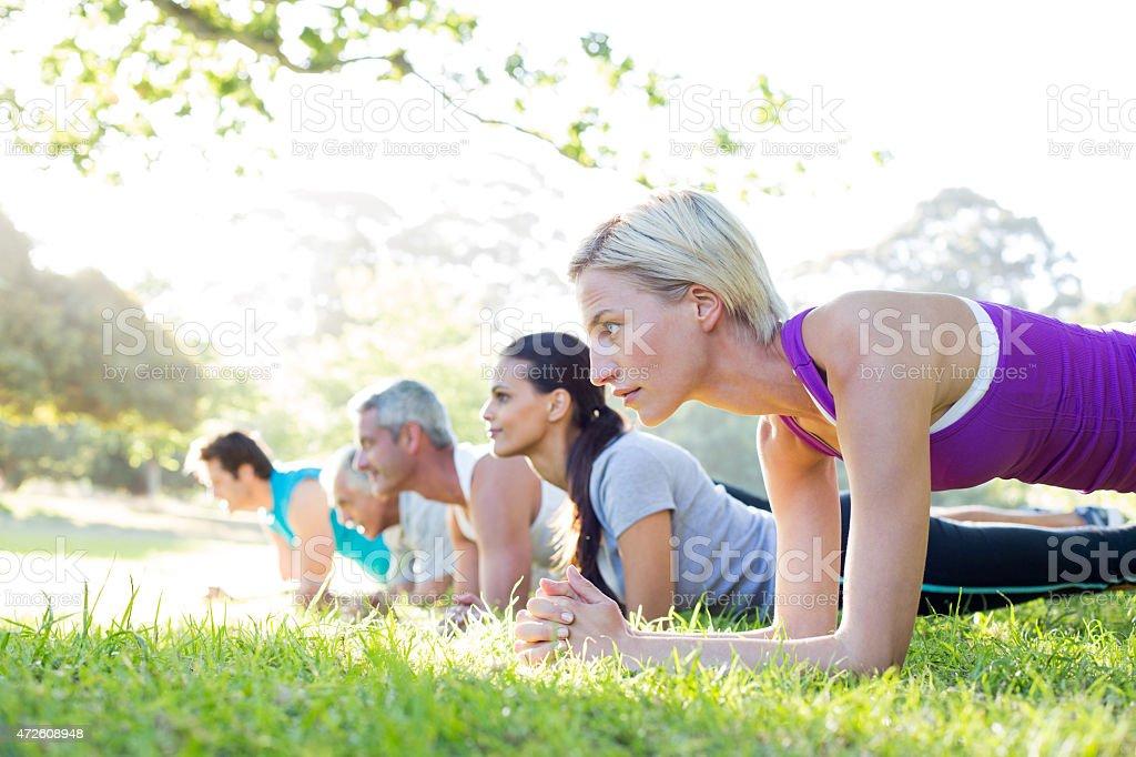 Happy athletic group training stock photo