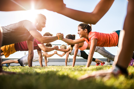 istock Happy athletic people cooperating while exercising on a sports training. 862263002
