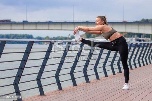 1142900322 istock photo Happy athletic woman doing  exercises 1252752624