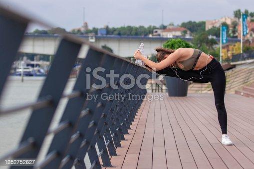 1142900322 istock photo Happy athletic woman doing  exercises 1252752627