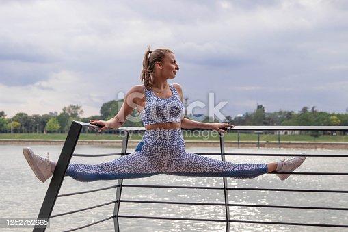 1142900322 istock photo Happy athletic woman doing  exercises 1252752665